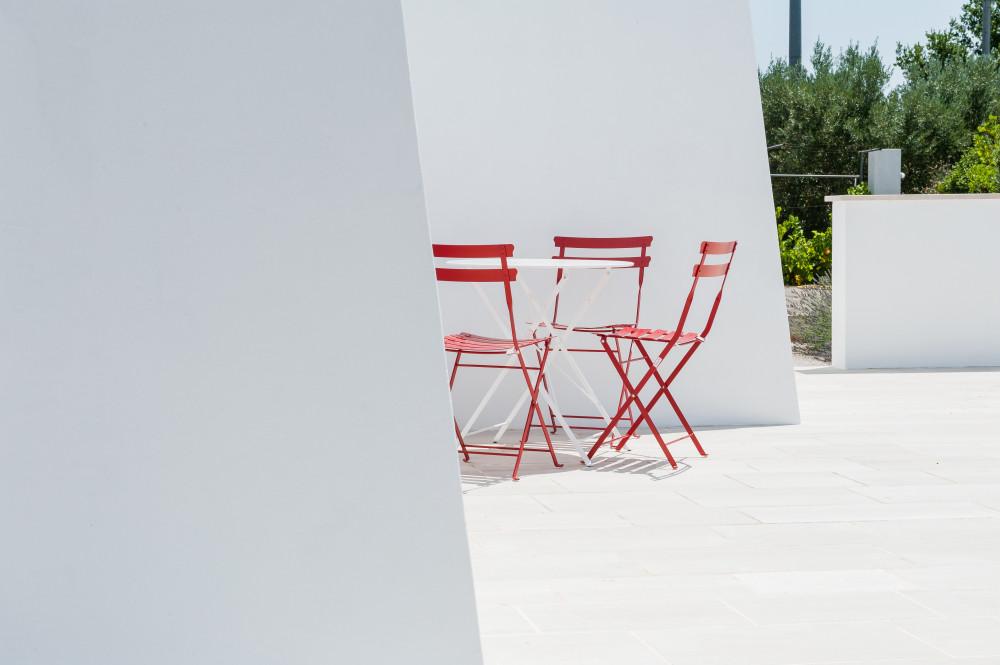 Angolo con sedie nella casa vacanze Tre Casiedde